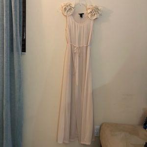 Floor length dress with floral shoulder detail
